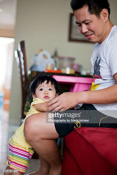 Baby girl playing with Daddy