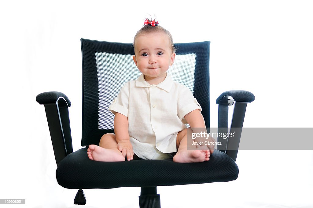 Sensational Baby Girl Sitting On Office Chair Stock Photo Getty Images Interior Design Ideas Apansoteloinfo