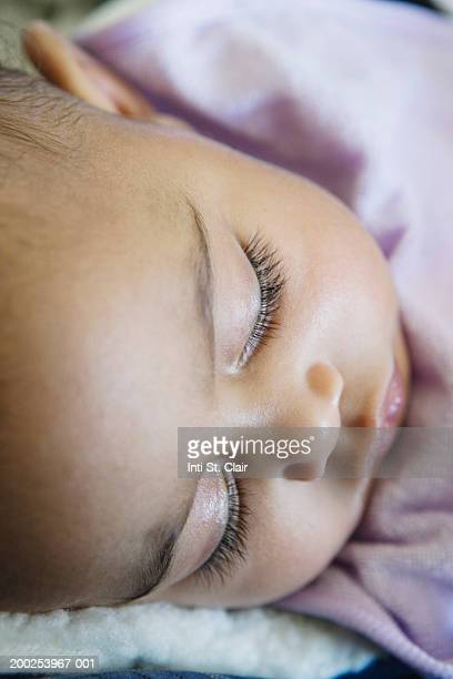 Baby girl (6-9 months) sleeping, close-up