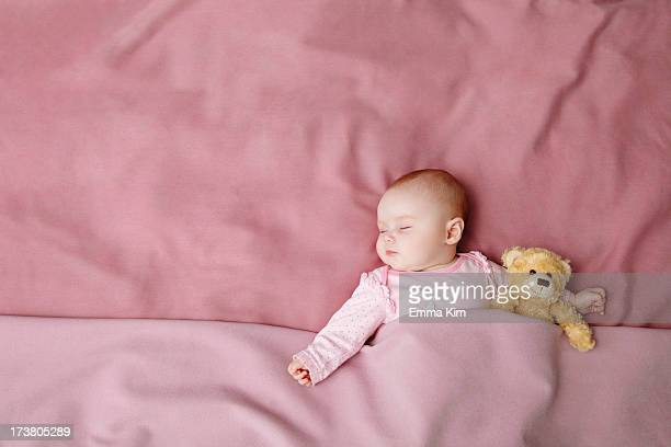 baby girl sleeping in bed - baby girls stock photos and pictures