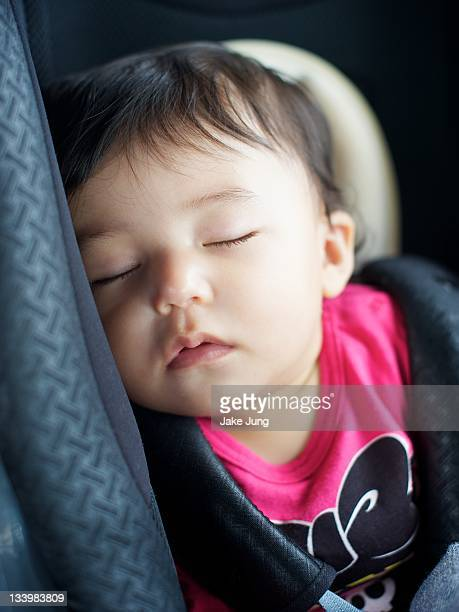 Baby girl sleeping in car seat