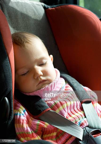 Baby girl sleeping in car seat