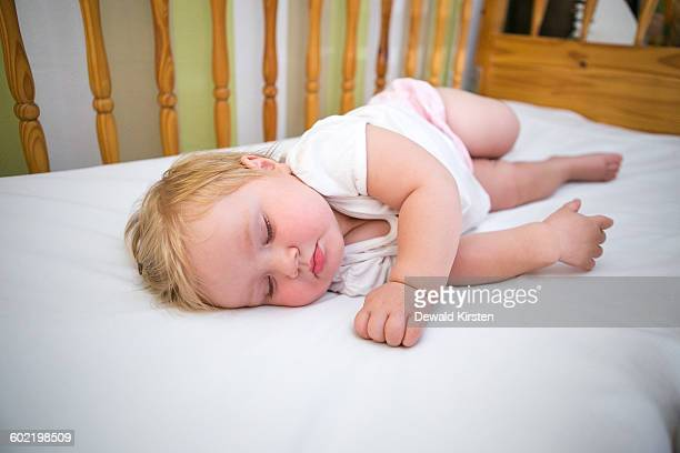 Baby girl (6-11 months) sleeping in cot, Worcester, Breede Valley, Western Cape, South Africa