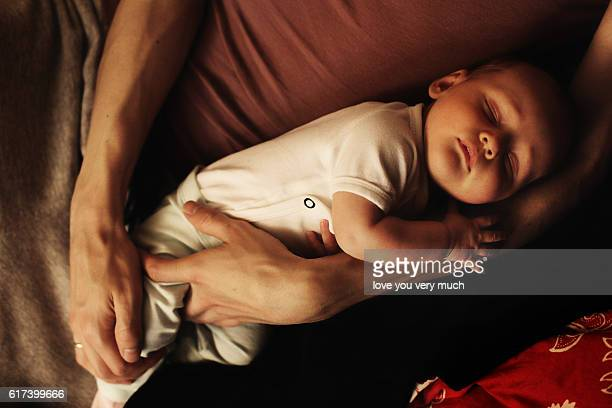 Baby Girl sleeping in fathers arms