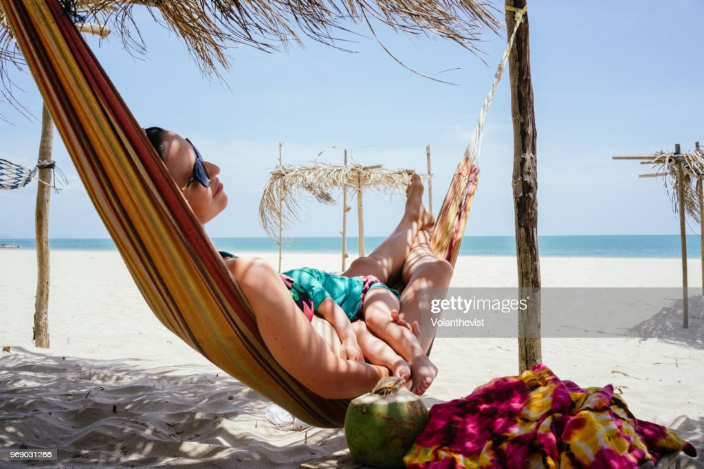 Baby Sleeping On A Hammock At The Beach In Thailand Stock Photo