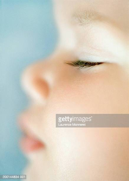baby girl (9-12 months) sleeping, profile, close-up - profil stock photos and pictures