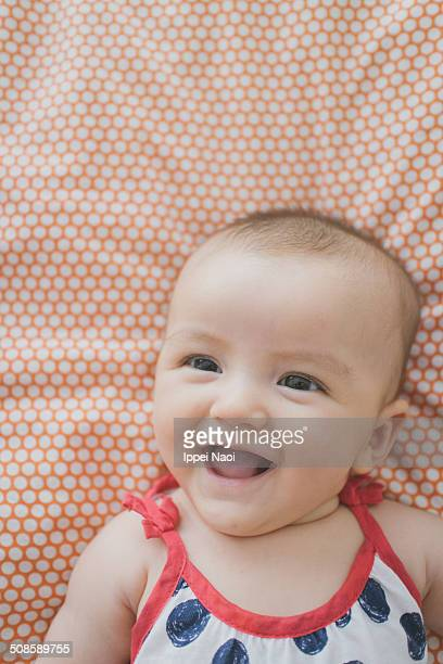 baby girl smiling - ippei naoi stock photos and pictures
