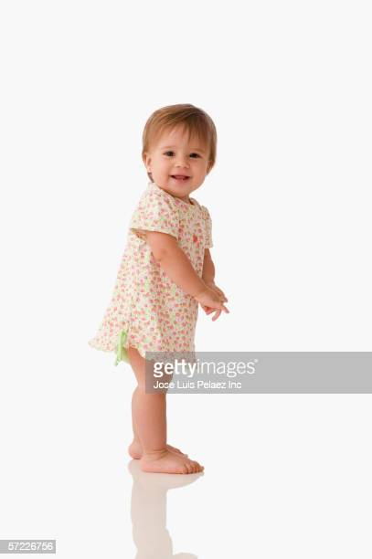 Baby girl standing up