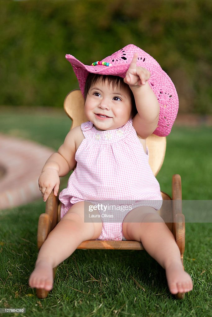 0fe2e7c371caf Baby girl wear pink cowboy hat   Stock Photo