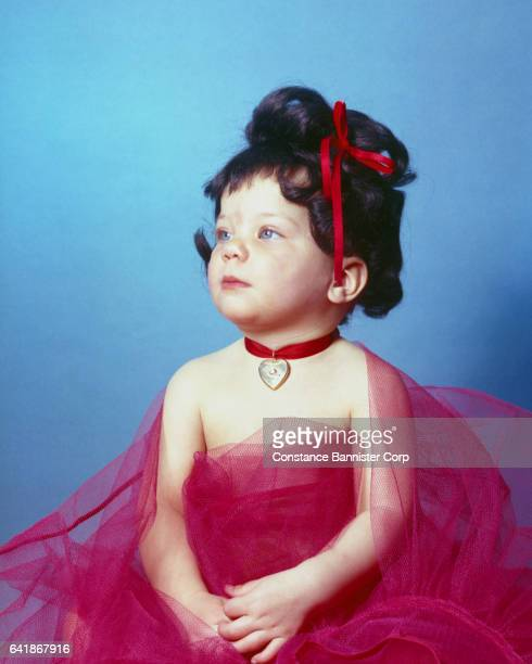 baby girl wearing black wig and red dress - {{relatedsearchurl(carousel.phrase)}} stock pictures, royalty-free photos & images