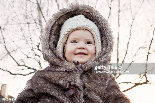 baby girl wearing fur coat outdoors, portrait - hairy girl stock pictures, royalty-free photos & images