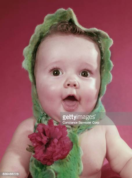 baby with mouth open wearing scarf