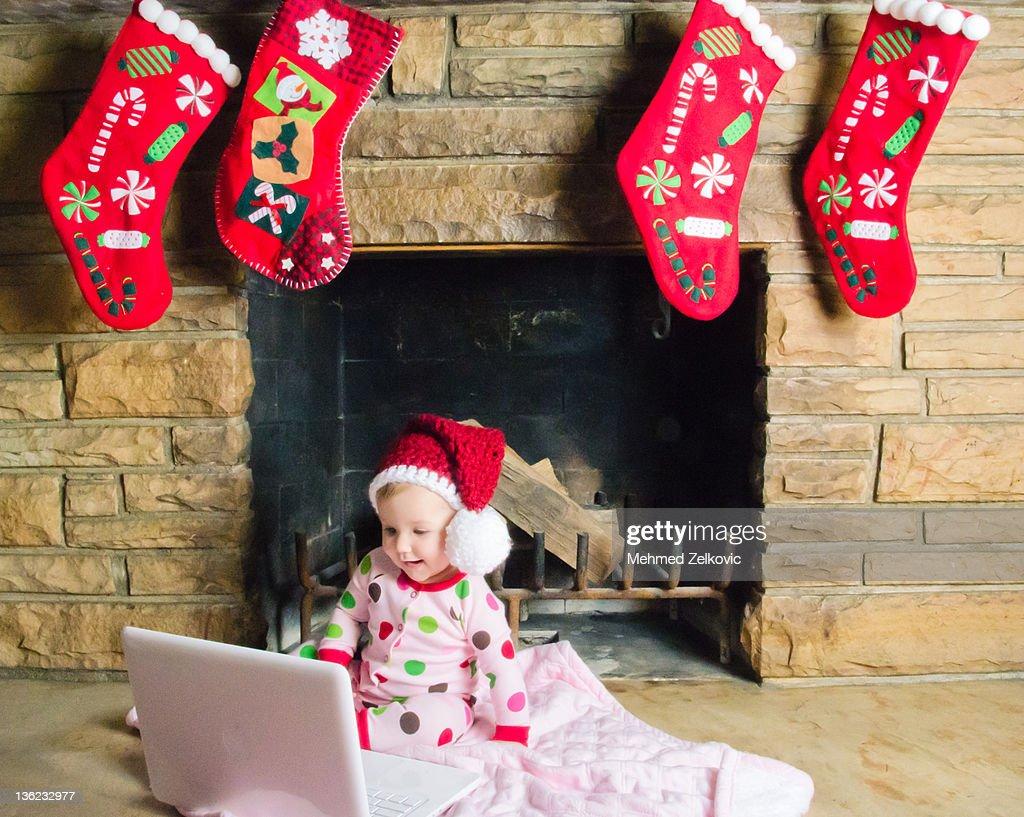 Baby girl wearing santa hat : Stock Photo