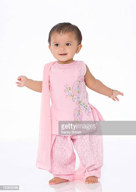Baby girl (12-18 months) wearing traditional Indian clothing in studio