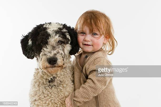 A baby girl with a dog