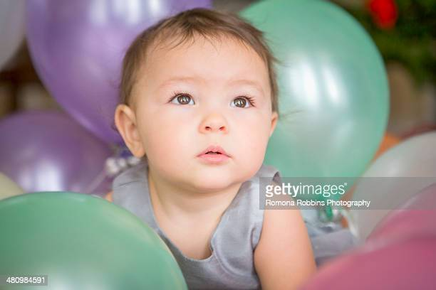 Baby girl with balloons