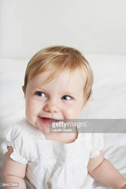 Baby Girl with Blonde Hair and Blue Eyes Smiling