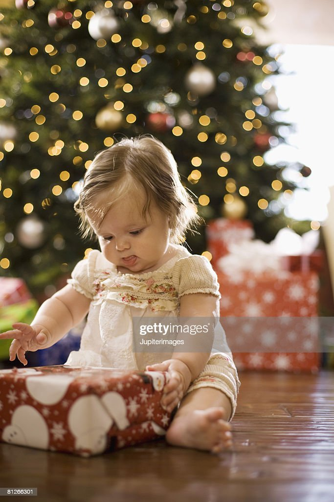 Baby girl with Christmas gift : Photo