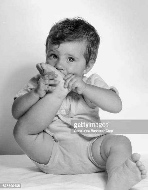 baby girl with foot in mouth - 1950 1959 photos stock photos and pictures