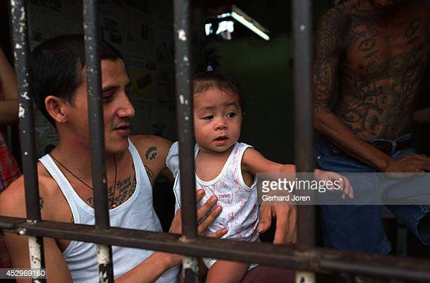 A baby girl with her father who is a member of Batang City Jail Gang one of four gangs at Manila City Jail The girl lives with her mother and father...