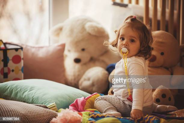 baby girl with pacifier - pacifier stock pictures, royalty-free photos & images