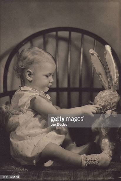 baby girl with stuffed bunny - somerville massachusetts stock pictures, royalty-free photos & images