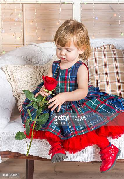 Baby girle with rose