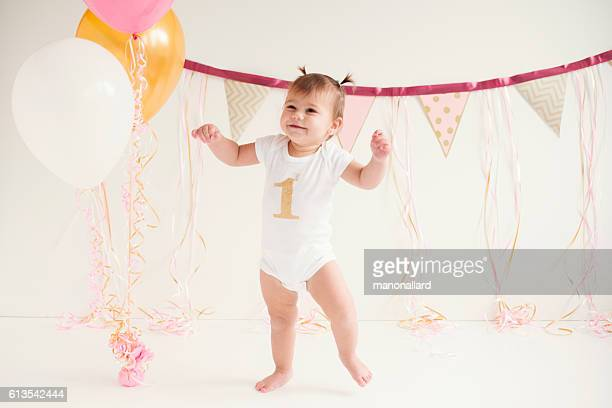 Baby girl's first birthday and first steps