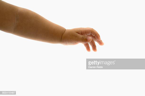 Baby girl's with outstretched hand