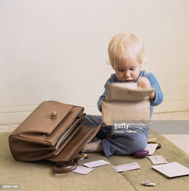 Baby going through mother's wallet and purse