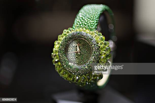 A Baby Grappoli model luxury wristwatch produced by De Grisogono SA stands on display during the 2017 Baselworld luxury watch and jewelry fair in...