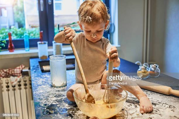 baby having fun making a mess in the kitchen - chaos stock pictures, royalty-free photos & images
