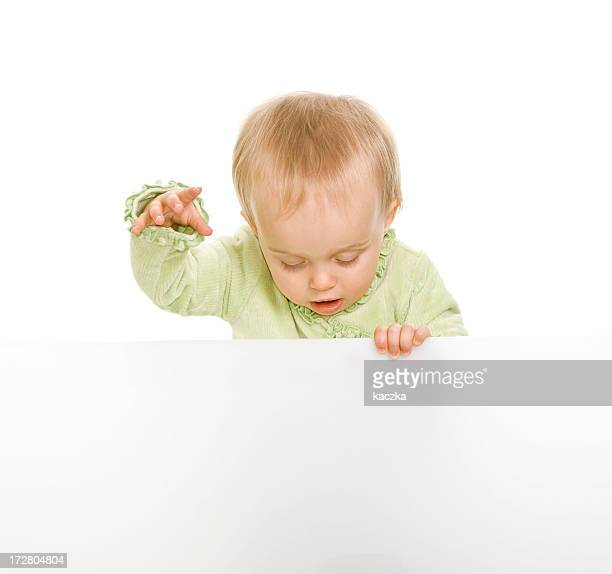 Baby holding sign or board isolated on white