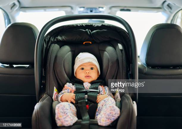 baby in a carseat - seat stock pictures, royalty-free photos & images