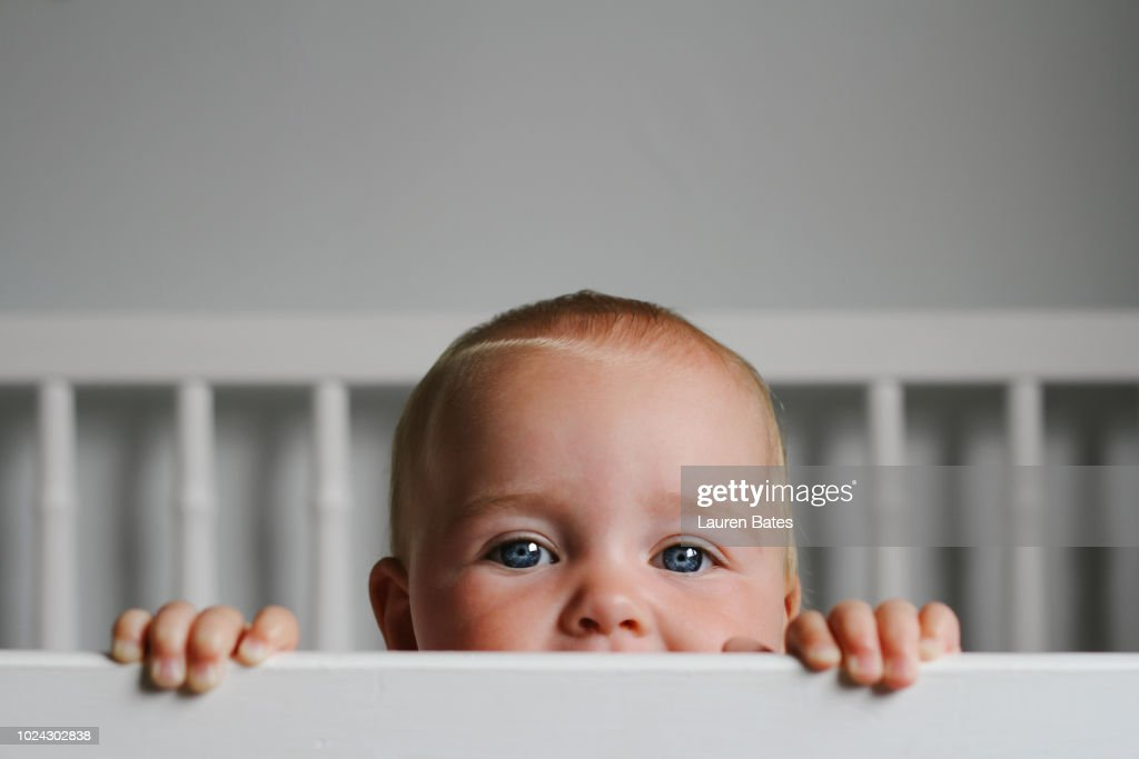 Baby in a crib : Stock Photo