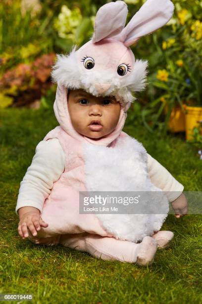 Baby in an Easter Bunny outfit.