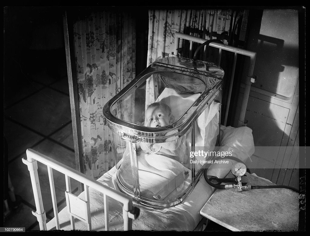 Baby in an oxygen tent 1944 A photograph of a baby in an oxygen tent & Baby in an oxygen tent 1944 Pictures | Getty Images
