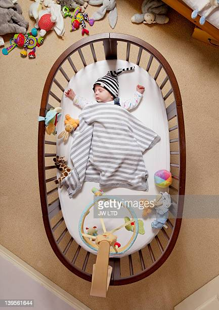 baby in cot viewed from above