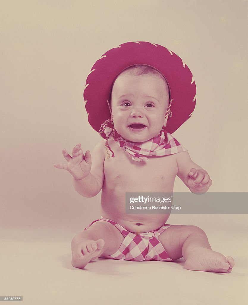 5d5ae27dea121 Baby In Cowboy Hat Stock Photo