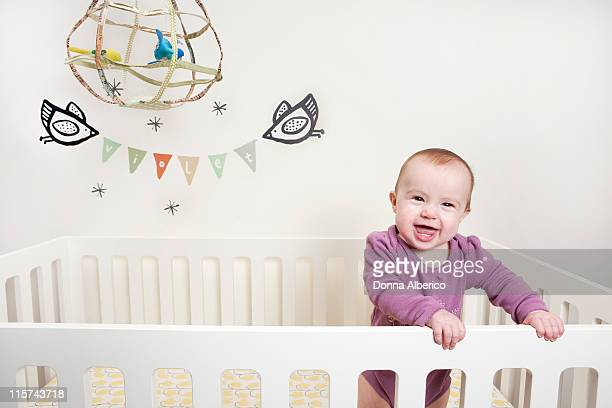 Baby in craddle in bedroom