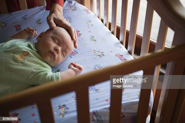 baby in crib - crib stock pictures, royalty-free photos & images