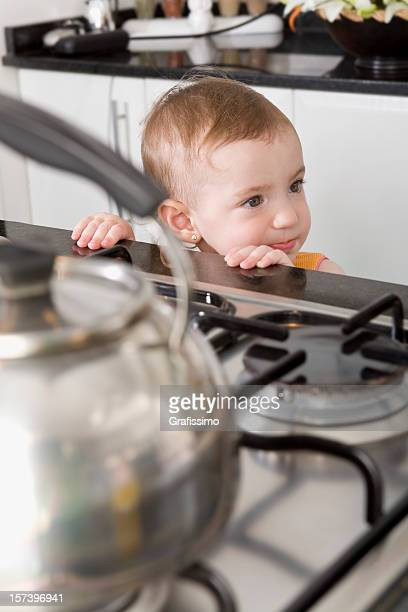 Baby in danger at kitchen stove