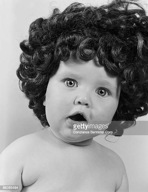 Baby in funny wig