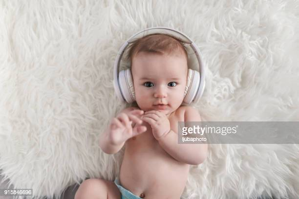 Baby in Headphones Listening to Music