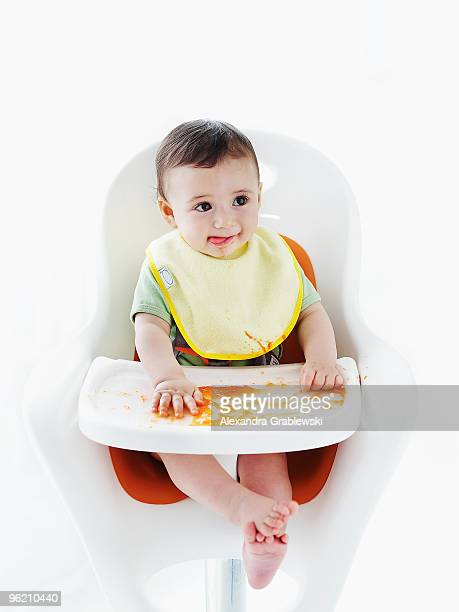 Baby in Highchair with Mess