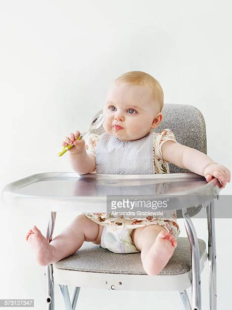 Baby in HighChair with Spoon