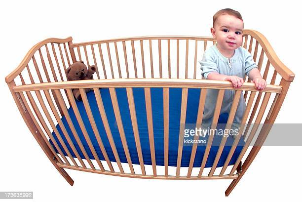 Baby in his crib with clipping path