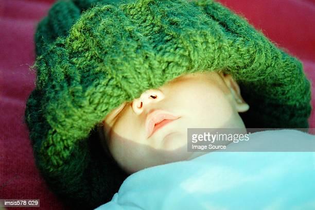 Baby in oversize woolie hat