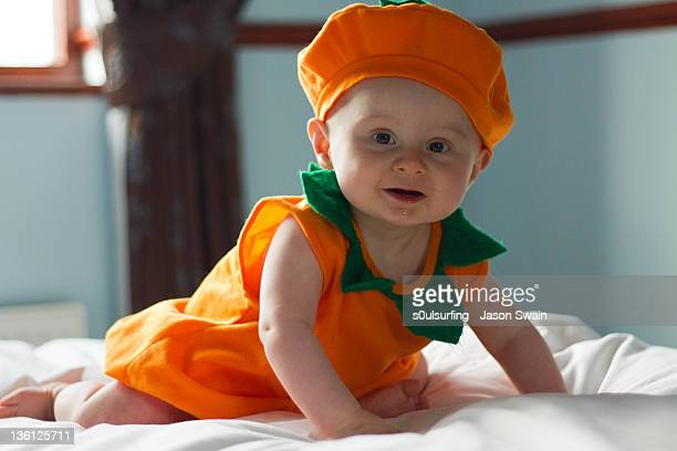 baby in pumpkin costume - s0ulsurfing stock pictures, royalty-free photos & images