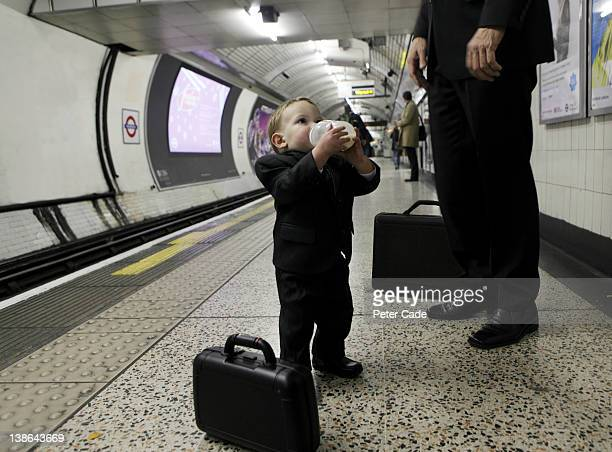 baby in subway, commuting - baby boys stock pictures, royalty-free photos & images